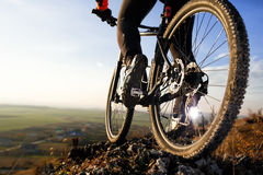 Closeup feet athlete mountainbiker and wheels of a sports bicycle Stock Photos