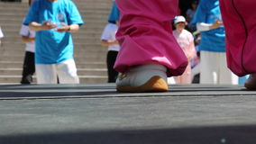 Closeup feet fitness coach training outdoor stock video