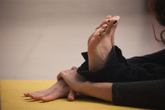 Closeup of feet and hands woman doing yoga Stock Photo