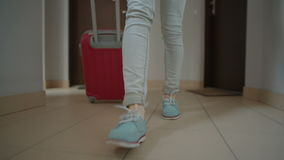 Closeup Feet of Lady Leaving the Apartment and Going with Suitcase Indoor stock footage
