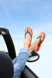 Closeup of feet leaning out of the window relaxing Stock Photo