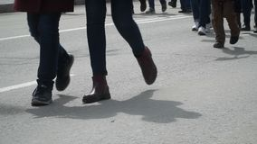 Legs. Closeup of the feet of many people in motion. Different shoes on the legs close-up. People in the crowd. Man is in a hurry to work. Hopeless stroll stock footage