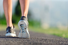 Closeup of feet on pathway. Feet of an athlete running on a park pathway training for fitness and healthy lifestyle Stock Images