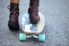 Closeup feet on skate board Royalty Free Stock Photos