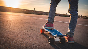 Closeup of the feet on the skateboard on the pavement Royalty Free Stock Photo