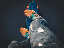 Closeup of the feet on the skateboard on the pavement Royalty Free Stock Photos