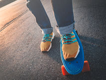 Closeup of the feet on the skateboard on the pavement Stock Images