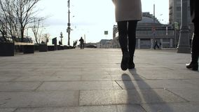 Closeup feet and tilt hiking of women legs boots, two girls walking in the city, steadicam shot, slow motion. Closeup feet and tilt hiking of women legs boots stock video footage