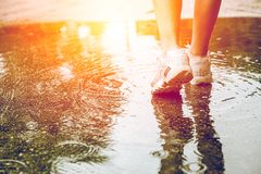 Free Closeup Feet Walking In Water At The Ground After Rain For Step Over Obstacles In Life To Next Good Thing Strong Royalty Free Stock Image - 164877636