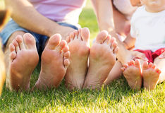 Closeup of feets lying in line at green grass Stock Photo