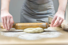Closeup of female baker's hands kneading dough in bakery. Close up Royalty Free Stock Images