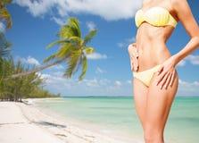 Closeup of female body in bikini at beach Stock Photos