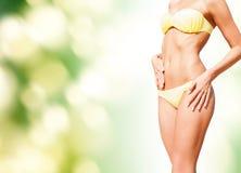 Closeup of female body in bikini outdoors Stock Images