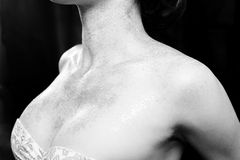 Closeup female breasts and naked shoulders in shining makeup Stock Image