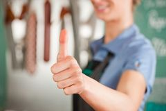 Female Butcher Showing Thumbs Up Sign Stock Photos