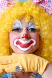 Closeup Female Clown. Closeup of female clown with bow in her hair Royalty Free Stock Image