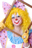 Closeup of Female Clown. Holding a picture frame Stock Image