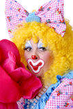 Closeup of Female Clown. With giant flower Stock Photos
