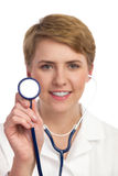 Closeup of female doctor holding stethoscope. Stock Photography