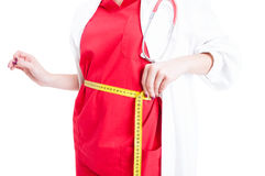 Closeup of female doctor measuring her waist Royalty Free Stock Photography