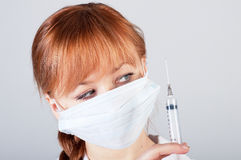 Closeup of a female doctor with syringe Royalty Free Stock Image