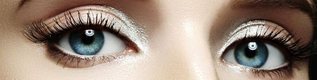 Closeup female eyes with bright make-up, great shapes brows, extreme long eyelashes. Celebrate makeup, luxury eyeshadows. Macro of beautiful eye. Good vision stock images