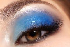 Closeup female eyes with bright make-up, great shapes brows, extreme long eyelashes. Celebrate makeup, luxury eyeshadows royalty free stock image
