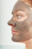 Closeup female face with clay mud facial mask Royalty Free Stock Photo