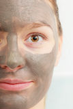 Closeup female face with clay mud facial mask. Spa beauty treatment and skin care. Closeup part of female face with clay mud facial mask Royalty Free Stock Photos