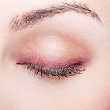 Closeup of female face with closed eye Stock Photography