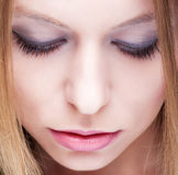 Closeup of female face with closed eye Stock Image