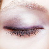 Closeup of female face with closed eye Royalty Free Stock Photo