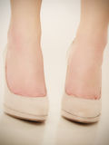 Closeup of female feet in beige high heels. Stock Image