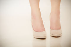 Closeup of female feet in beige high heels. Royalty Free Stock Photos
