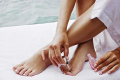 Closeup of female feet and hands royalty free stock photos