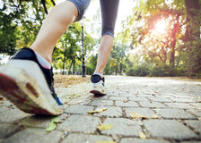 Closeup of female feet while jogging Stock Images