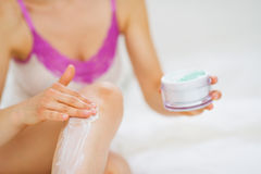Closeup on female hand applying creme Stock Image