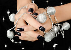 Closeup on female hand with black manicure. Royalty Free Stock Photo