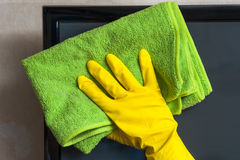 Closeup of female hand cleaning lsd tv. Cleaning concept Stock Photo