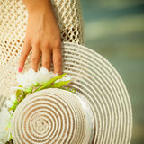 Closeup female hand with hat Royalty Free Stock Images