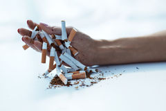 Closeup Of Female Hand Holding Cigarettes. Quit Smoking royalty free stock images