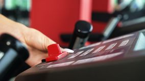 Closeup female hand selects the loading mode on the scoreboard of treadmill. Closeup female hand selecting the loading mode on scoreboard of treadmill. Health stock footage