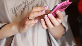 Closeup of female hand using a smart phone stock footage