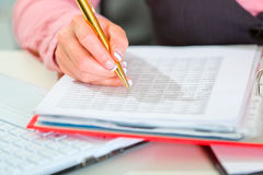 Closeup on female hand writing in document Royalty Free Stock Photos