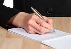 Closeup of female hand writing Stock Image