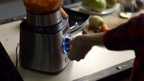 Female hands blending detox smoothie in blender stock video