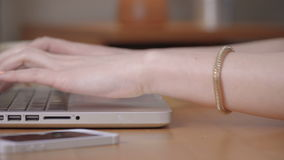 Closeup of a female hands busy typing on a laptop. stock video footage