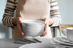 Closeup of female hands. Holding saucers Stock Photography