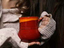 Hands holding mug of hot drink, closeup Stock Photography
