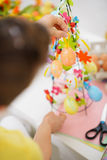 Closeup on female hands making Easter decoration Stock Photos